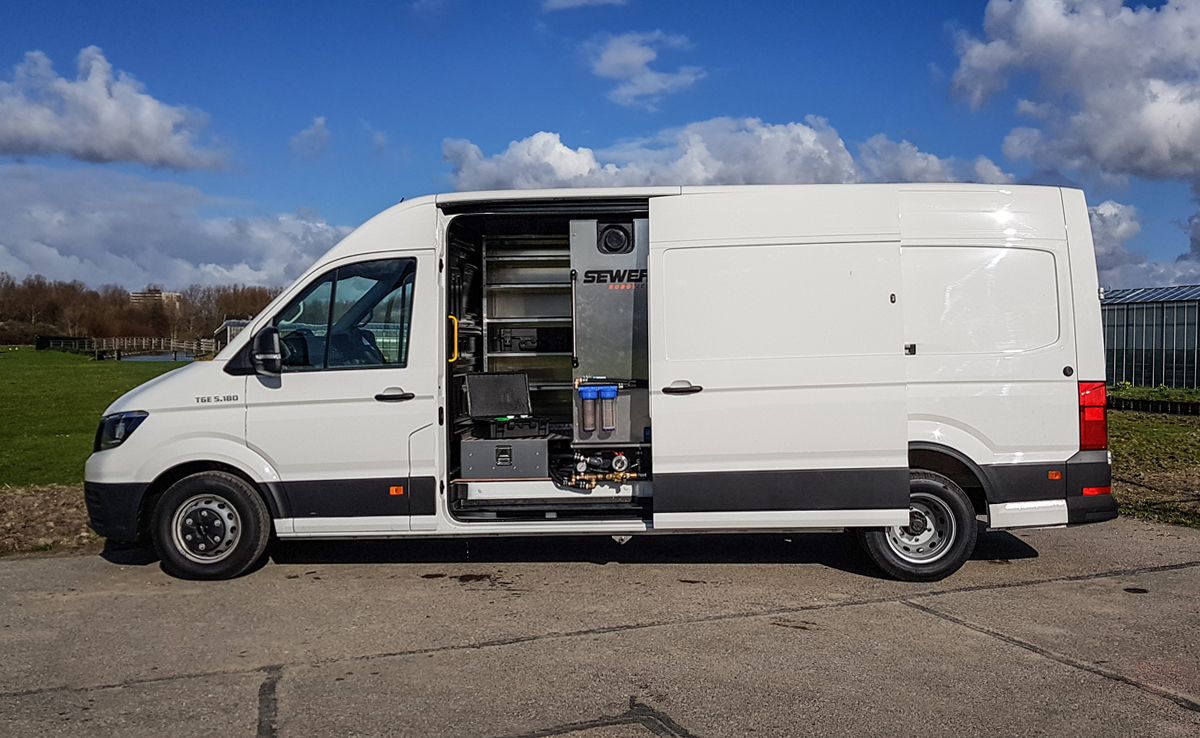 Lateral view of van with open storage space